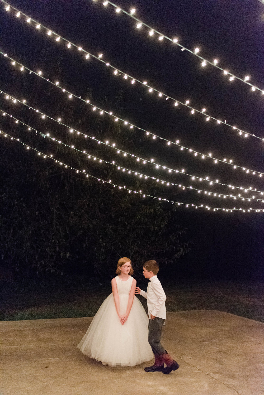 flower girl ring bearer bistro string twinkly lights wedding planner northern virginia