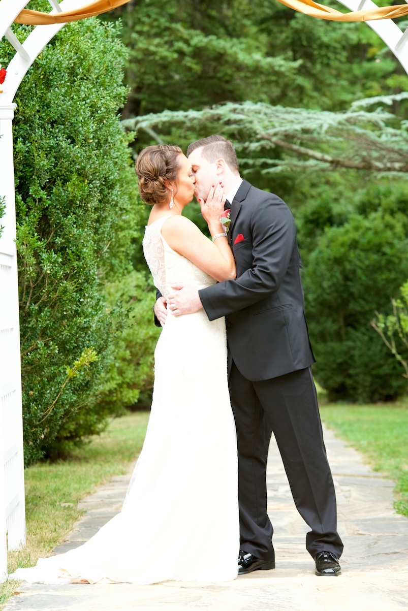 wedding-firstkiss-ceremony-man and wife-photos.jpg