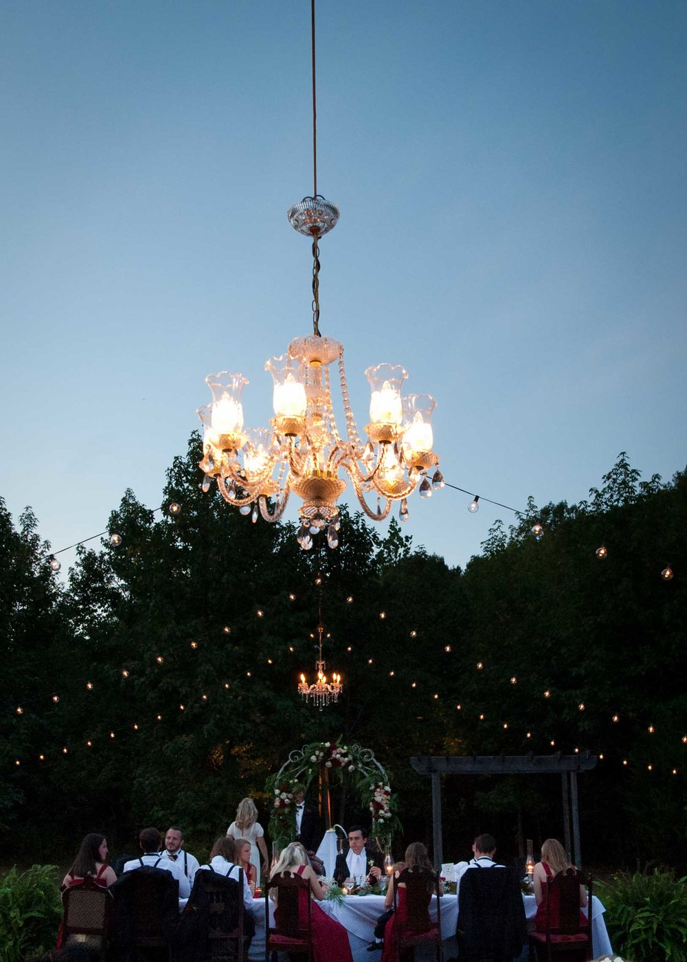 outdoor wedding reception chandelier twinke string lights inspiration.jpg