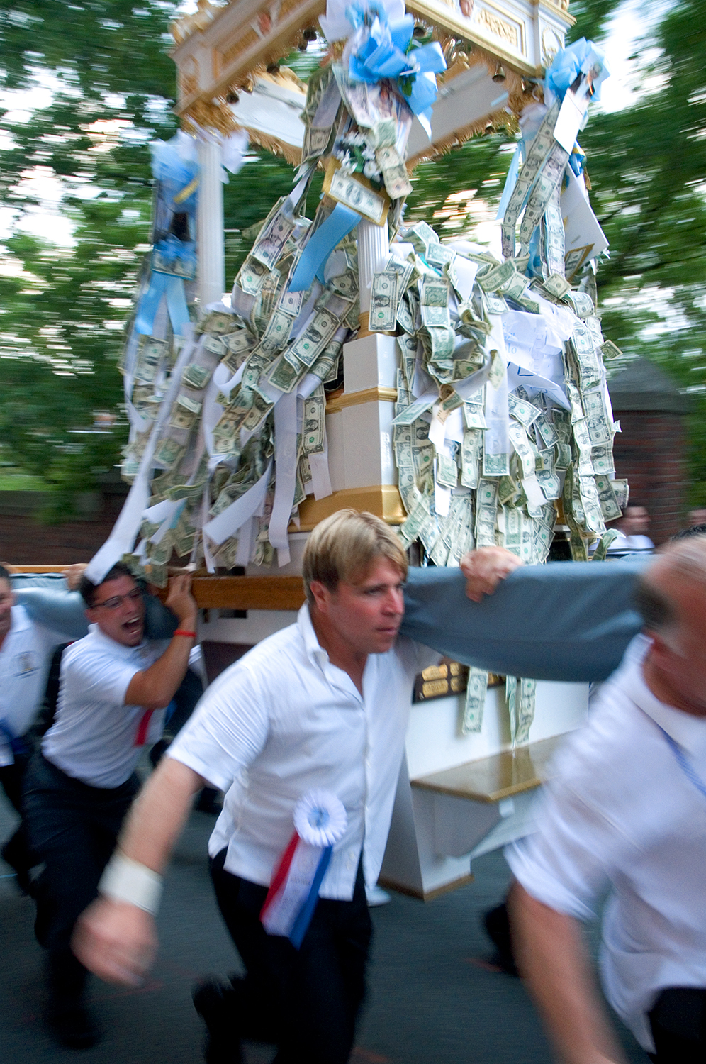 Man of the Fisherman's Feast run Madonna del Soccorso di Sciacca up a steep hill at Boston's North End.
