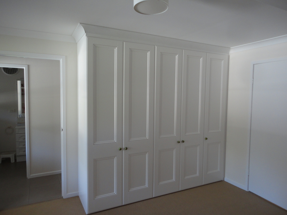 Built in robe with Queenslander recessed doors.