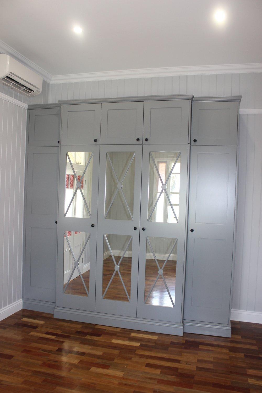 Custom designed Wardrobe with Fretwork mirrored doors