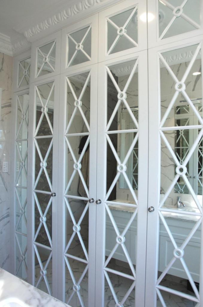 Custom design wardrobe with fretwork mirrored doors