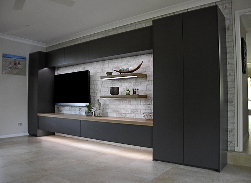 Entertainment Unit_Asphalt Cabinetry and Prime Oak benchtop shelving_recessed LED_full length.png