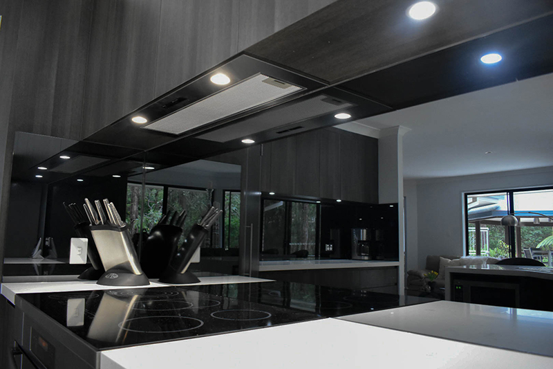 Kitchen_close up stone pompeii and cool white downlights over cooktop.jpg