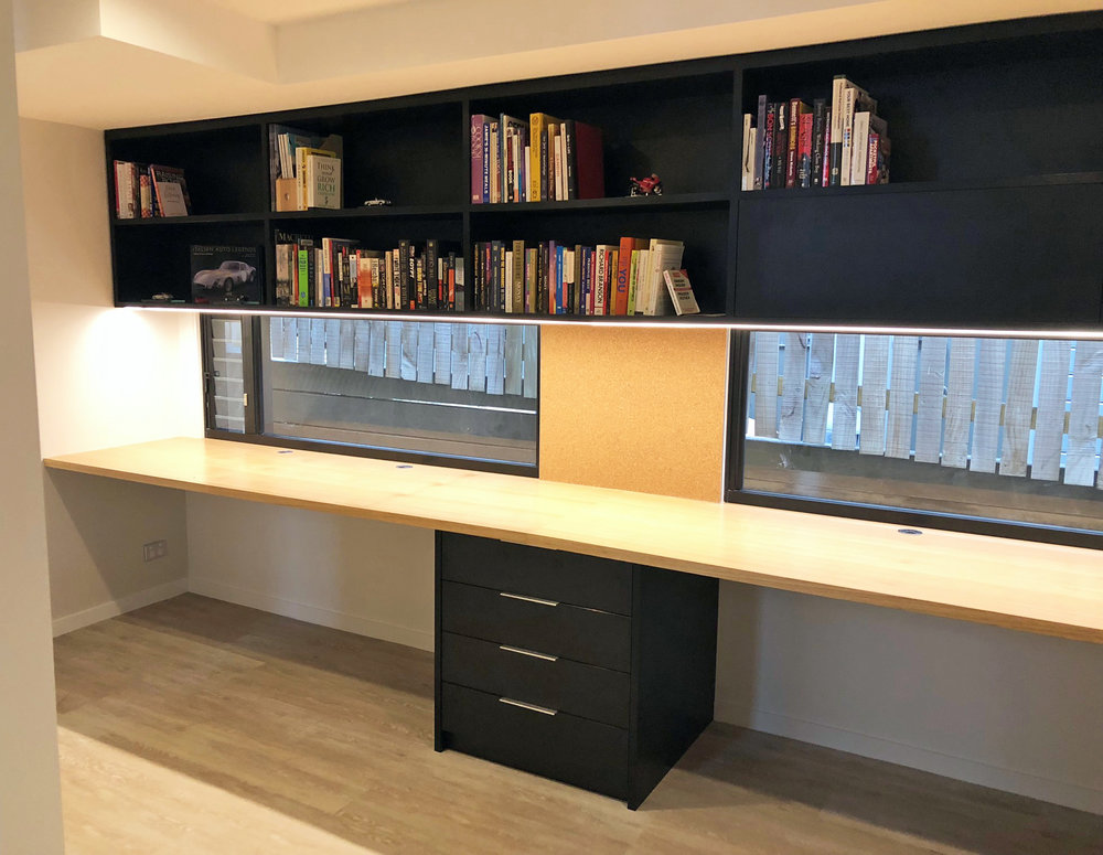 Study desk & cabinetry_American Oak Veneer benchtop and Estella Oak externals with open shelving, drawers and corkboard.jpeg