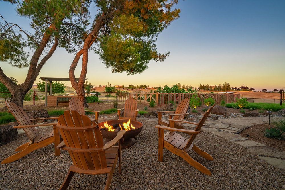 fire-pit-at-dusk-with-pine-trees.jpg