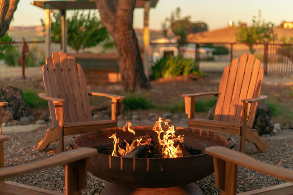 fire-pit-with-flames-and-chairs.jpg