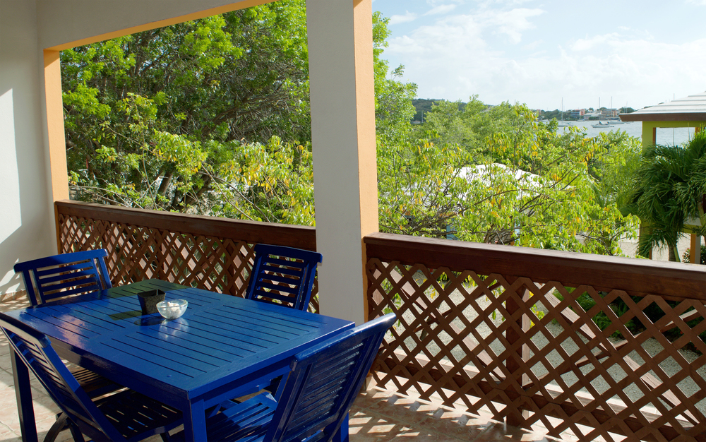 Enjoy a meal overlooking the property and bay