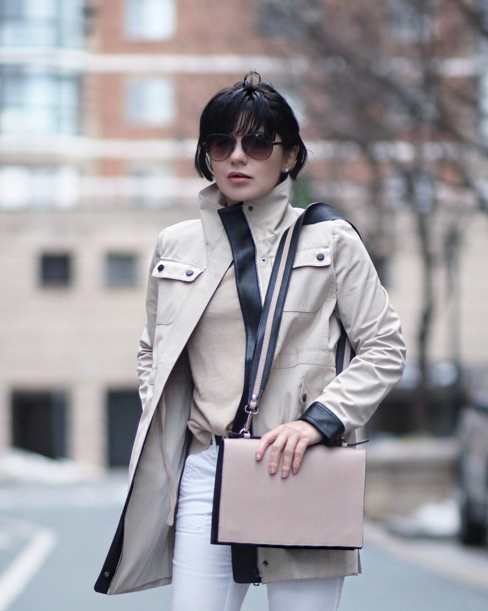 beige trench coat and bag