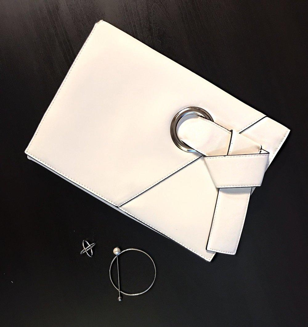 white clutch silver pearl bracelet
