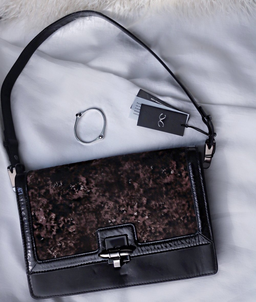 Monica Chiang bag and silver bracelet
