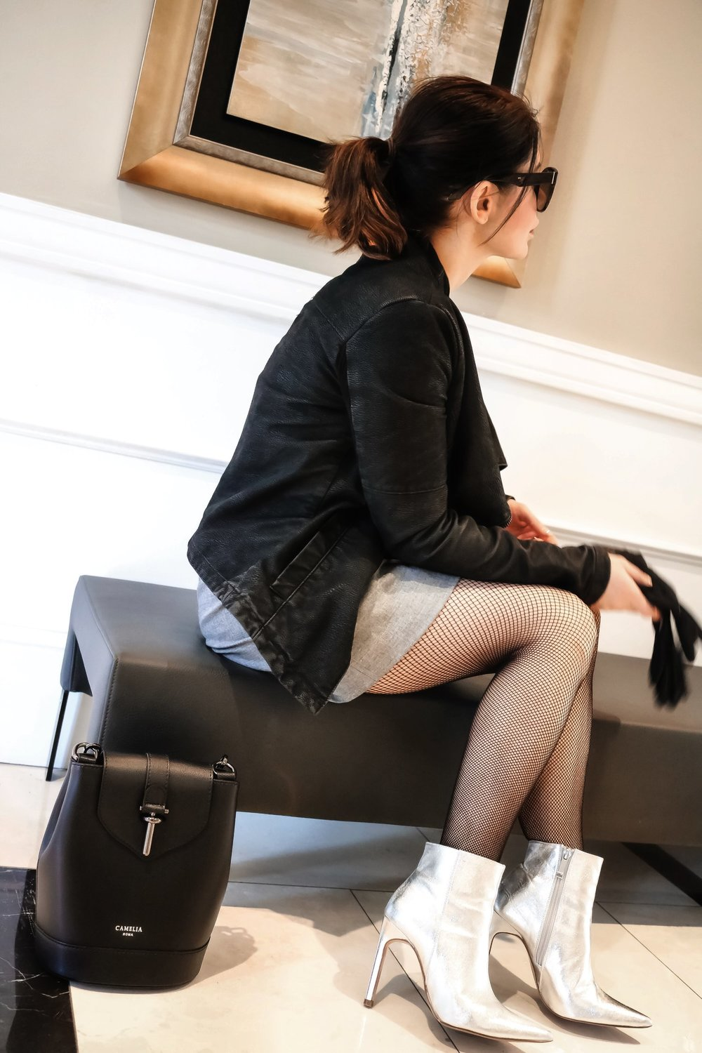 Girls-night-out-sitting-silver-boots