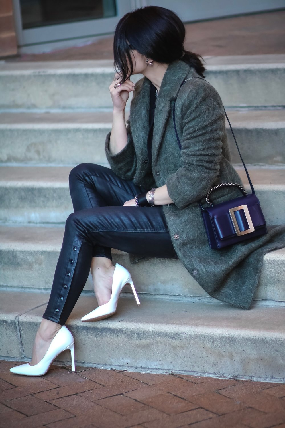 Isabel-Alexander-sitting-down-stairs-wearing-Asos-khaki-coat-boyy-buckle-bag