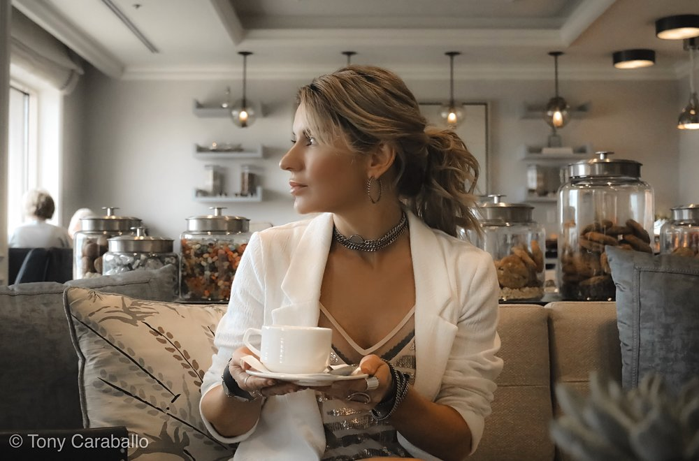 Ritz Carlton Club Lounge Isabel Alexander enjoying coffee