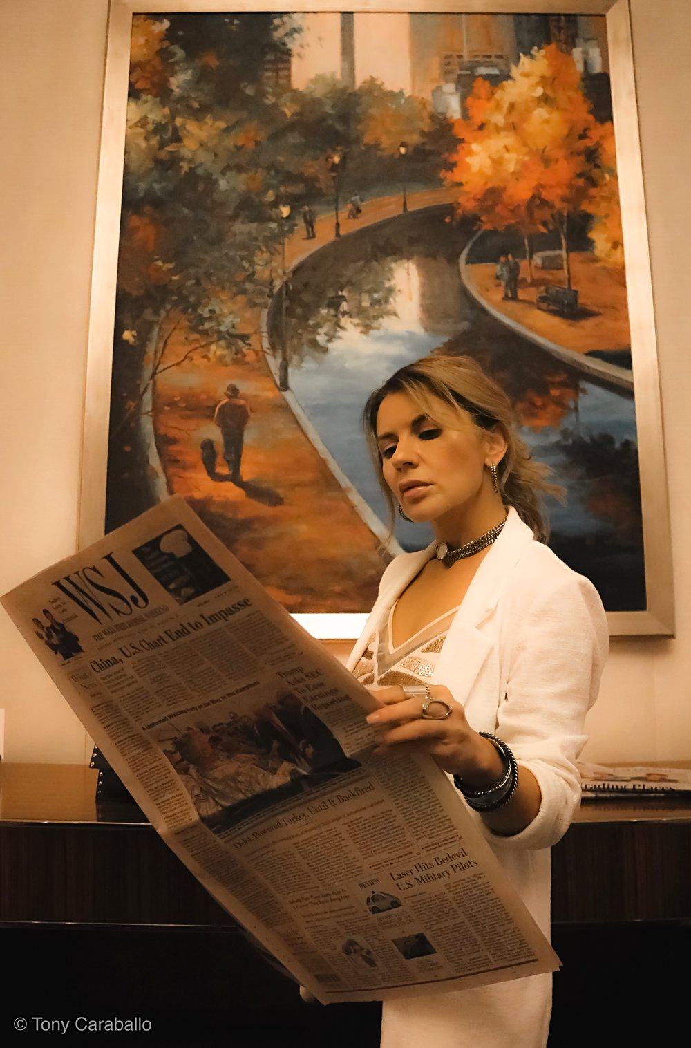 Ritz Carlton Isabel Alexander reading the newspaper in the lobby