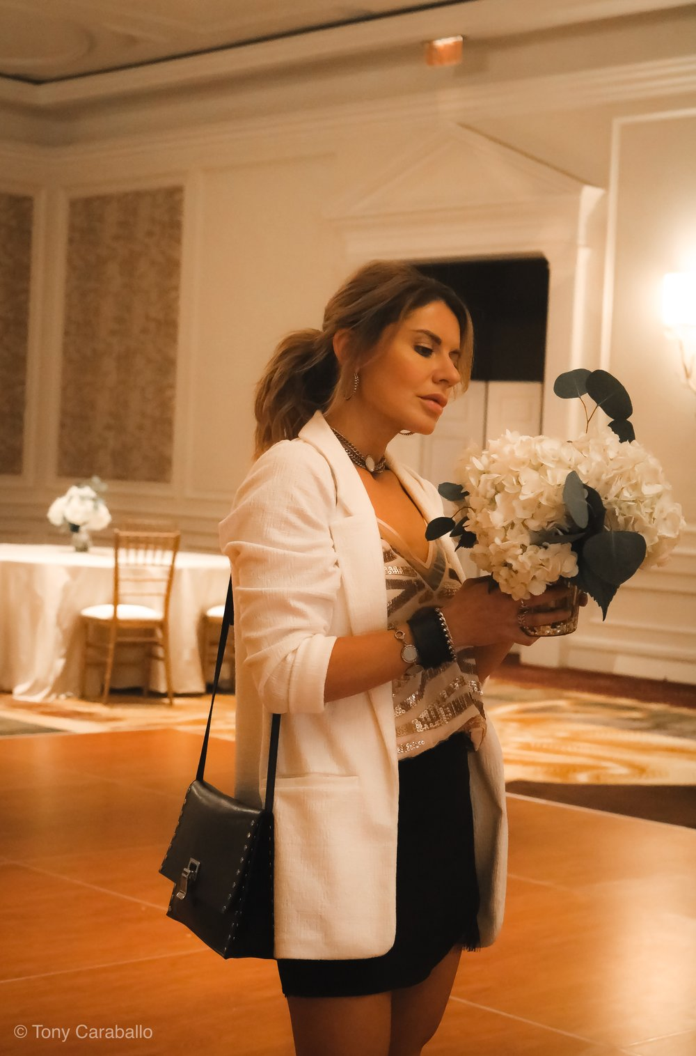 Ritz Carlton Tysons Corner Isabel Alexander holding a bouquet