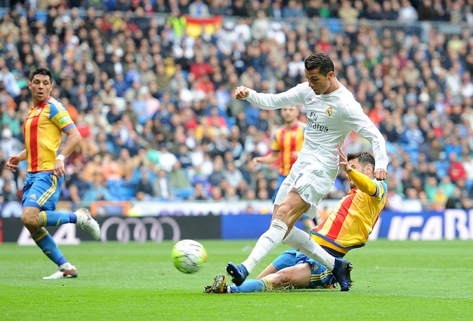 real-madrid-forward-cristiano-ronaldo-against-valencia-defenders.jpg