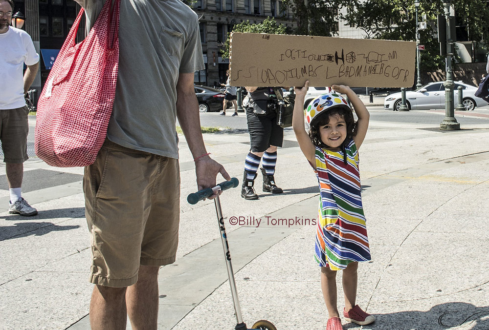 Little girl  with her first ever, self made  protest sign