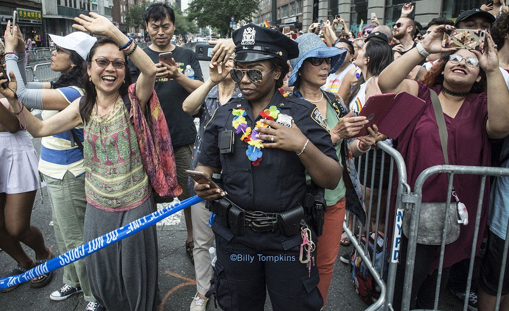 Female cop during Gay Pride parade / NYC