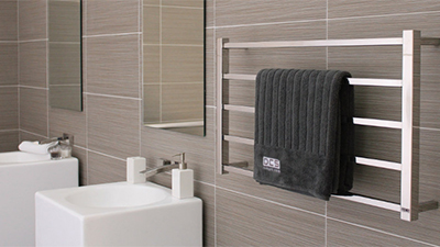 Keep your towels dry and warm, and make a design statement, with a ladder or modular rails.