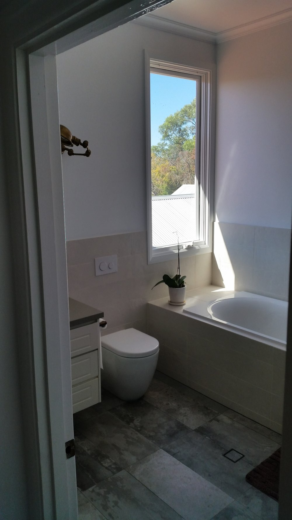 Bathroom renovation after - New window + bath