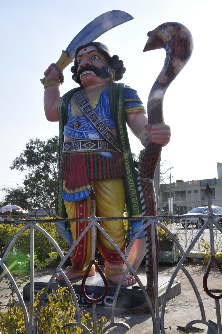 At the top of the hill stands the colourful, giant statue of Mahishasura, sword in one hand, serpent in the other.