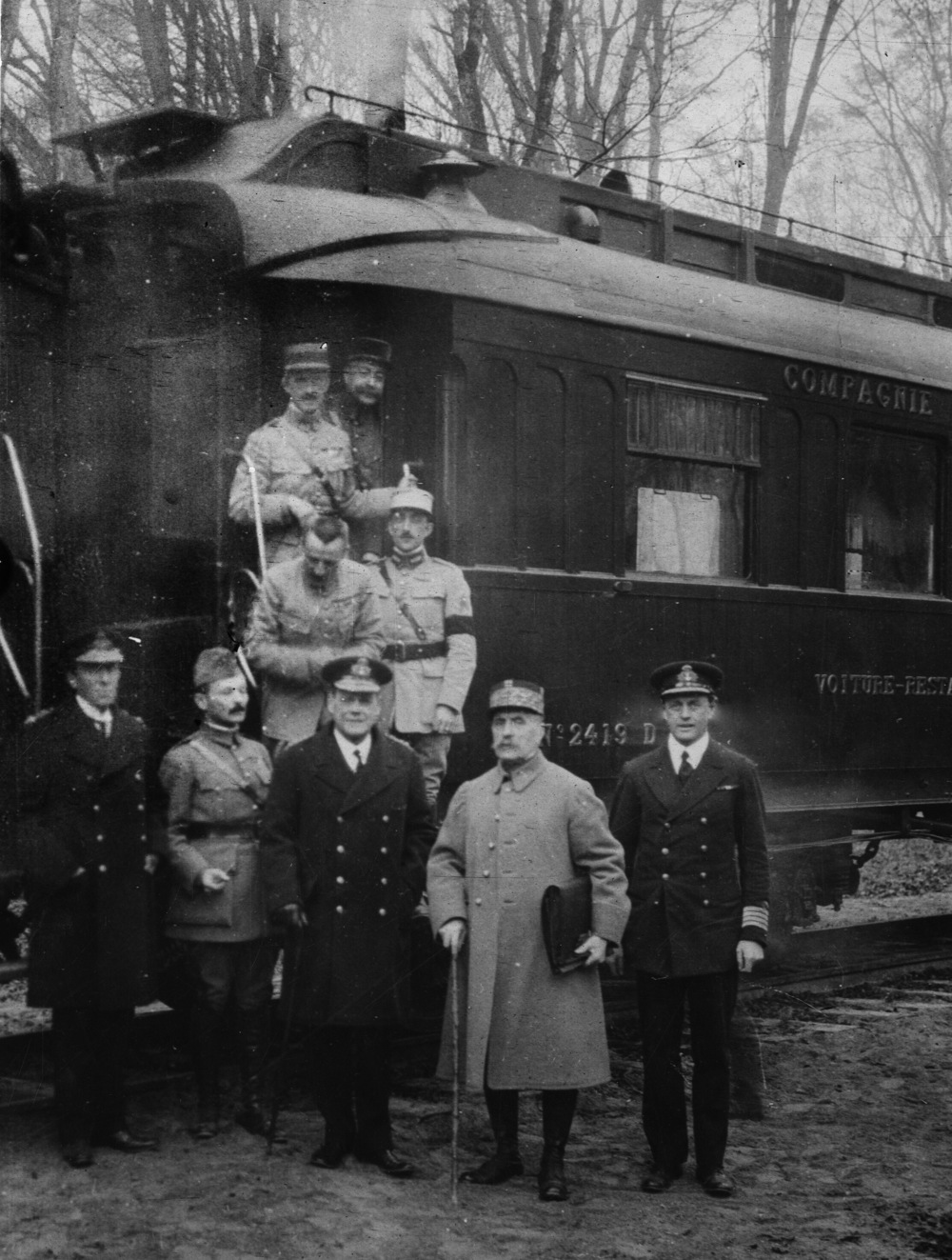 Marshal Foch with members of the Allied delegation outside the railway carriage where the armistice with Germany was signed.