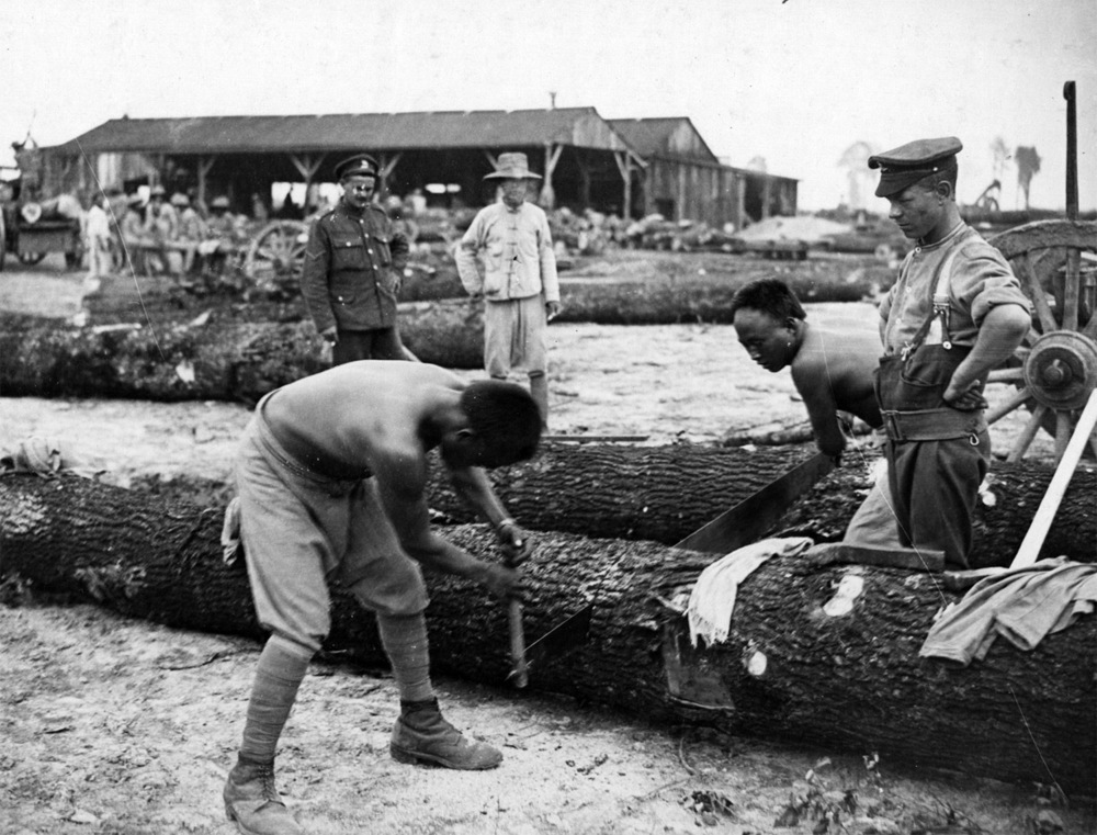Chinese labourers at work on the Western Front, supervised by white British troops.