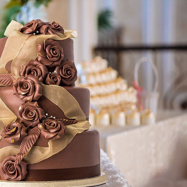 All our wedding cakes are beautifully handcrafted and can be tweaked according to your taste and style. . . . Alternatively, why not give us a call and take advantage of our fully bespoke service? . . . Pictured is our popular Chocolate Cascading Rose cake - three tiers of Madeira chocolate sponge, accented with rich ganache and covered in hand-crafted roses. #chocolateweddingcake #chocolateweddingcakes #chocolatewedding #mmmcake #bridetobe #bridetobe2018 #chocolatelover #weddinguk @welshweddings @weddingideas @brides @perfectweddingmag