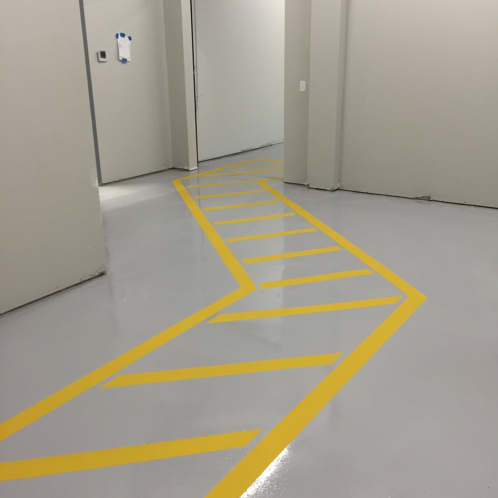 Safety Flooring, warehouse striping, warehouse safety flooring, line striping, caution flooring, epoxy safety flooring,