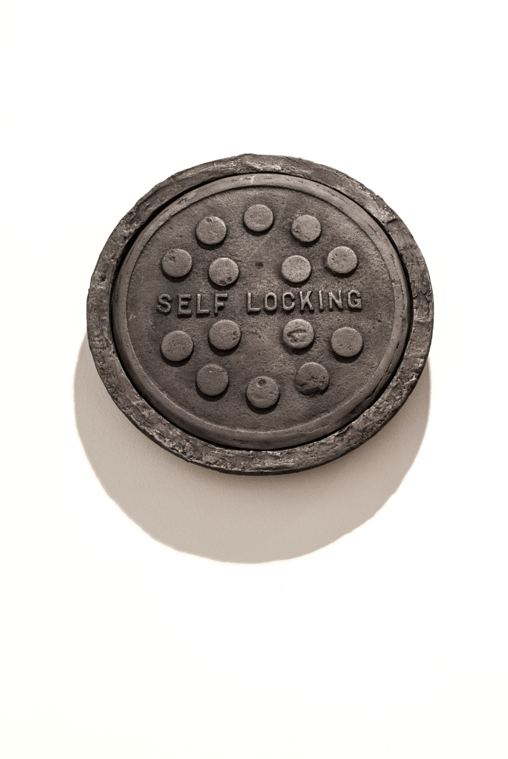 Commemorate WC1, 2013 Coal hole covers cast in compressed charcoal dust