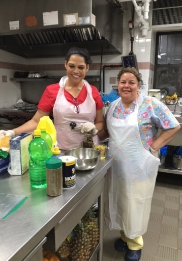 Nelba Bonilla and Maria Cruz making homemade salad dressing at Cypress Hills LDC