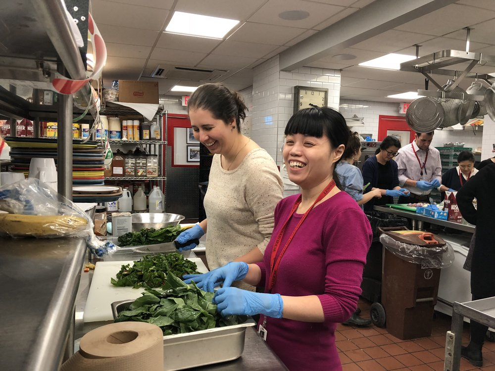 Yin and Lauren chopping spinach.JPG