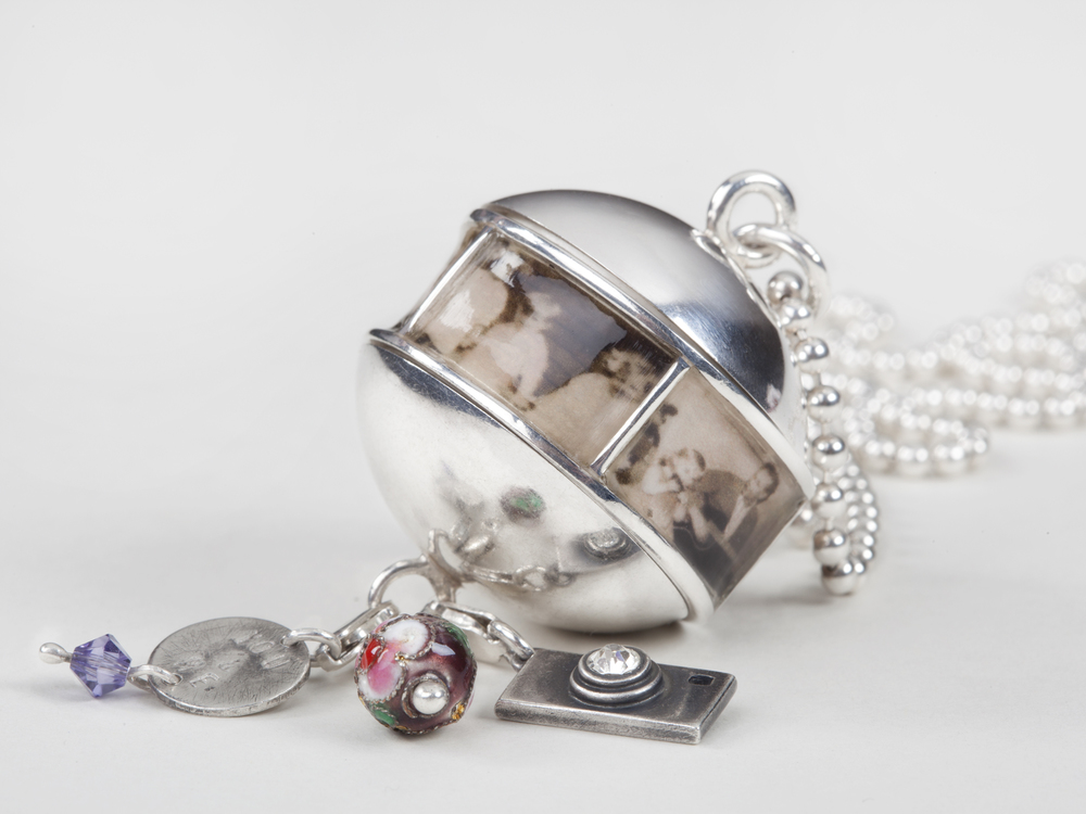 you & me   – 2010   – silver, resin, old pictures and detachable charms