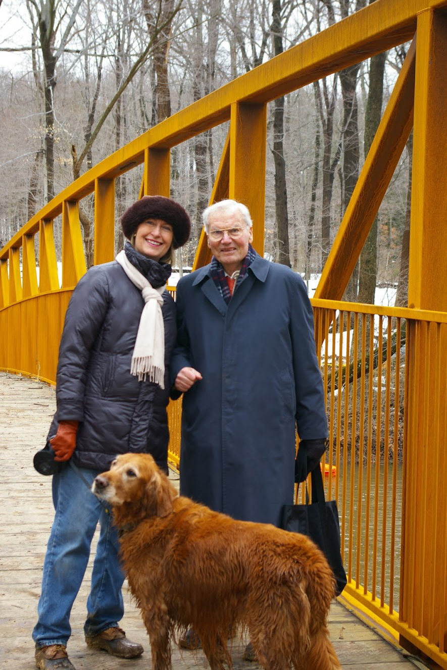 Wendy Mager, FOPOS board president, and Helmut Scwab on the Stony Brook footbridge