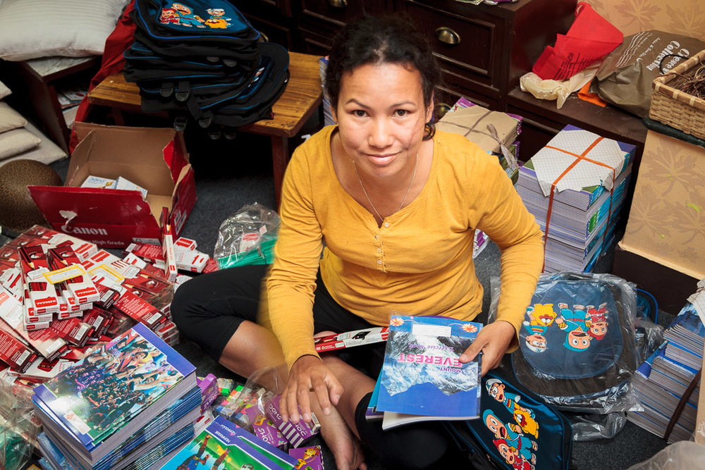Rewati Gurung packing the first of the Moving Mountain School Bags for delivery tomorrow morning.