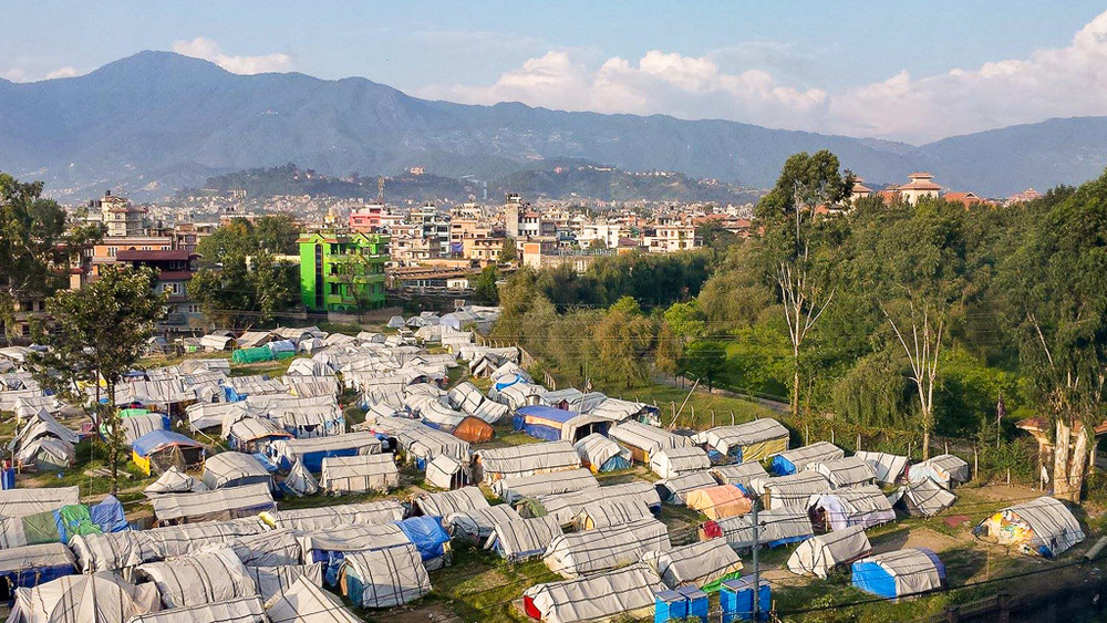 On the northern side of Kathmandu, a tent community struggles with normal everyday living. Now the economic blockade, shortage of fuel and supplies has created an even bigger challenge for these people who lost everything they owned during the earthquakes of April 25 and May 12, 2015