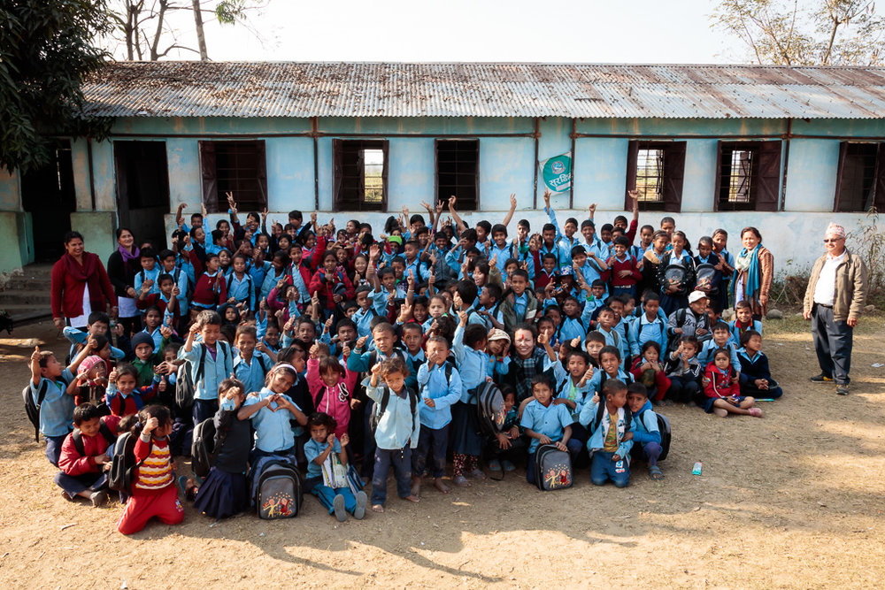 School children gather for a group photo at the end of the donation day in Dudhauli, Sindhuli District of Nepal.