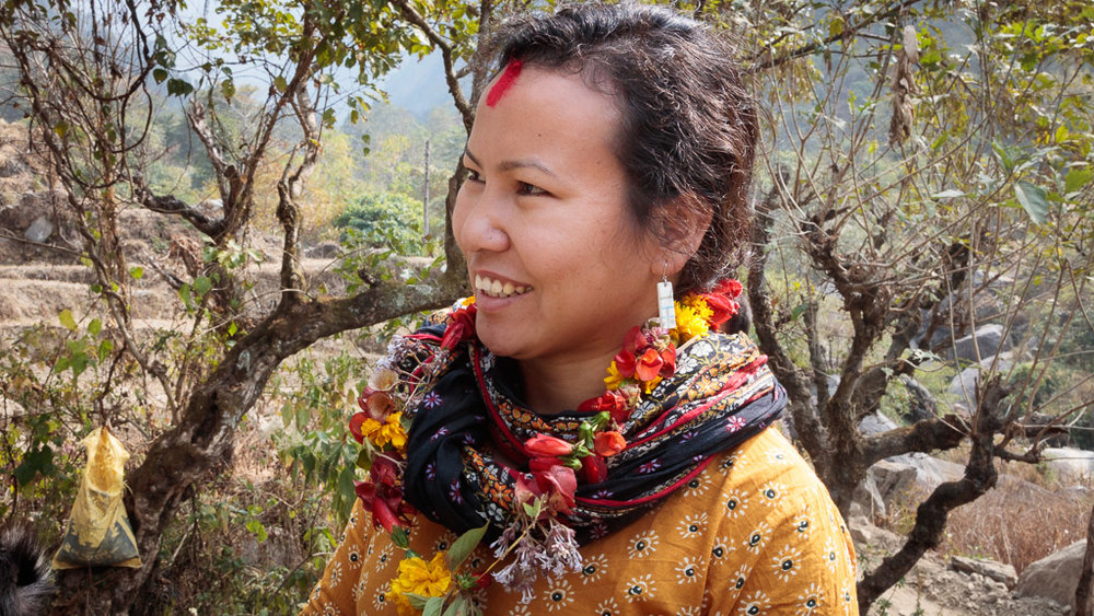 Rewati Gurung, founder of Moving Mountain Nepal (NGO) with a garland of fresh flowers and 'tika' on her forehead.
