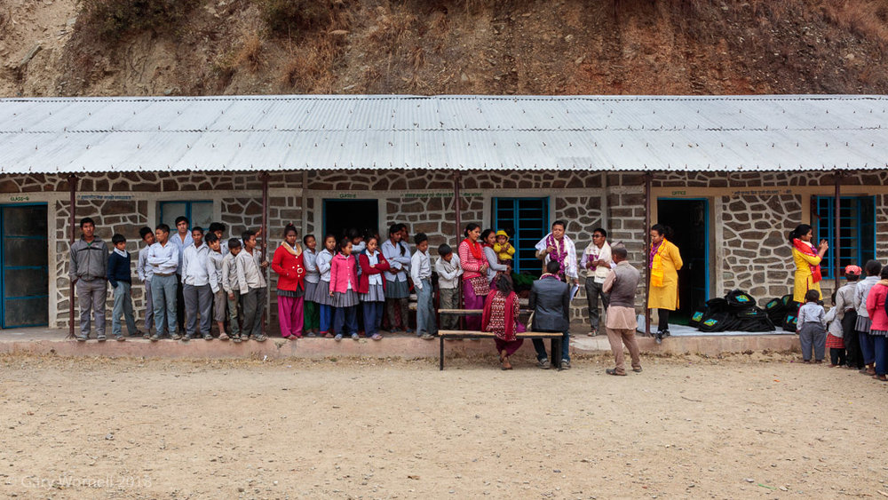 Rewati Gurung, local community members, teachers and students prepare for the donation.