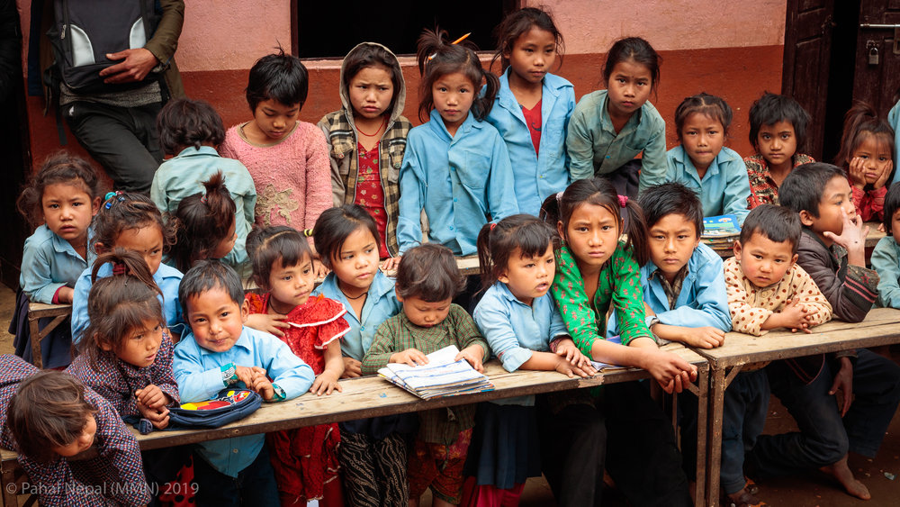 Children at Bhumistan wait for donations to start.