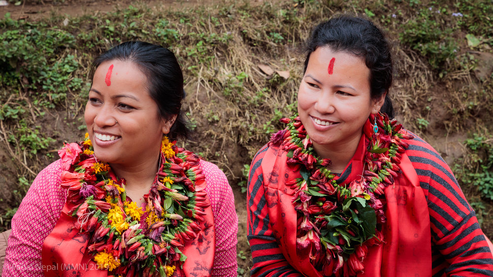 Anita Prajapati - Executive Director of Unatti Foundation in Bhaktapur and Rewati Gurung CEO of Moving Mountain Nepal with fresh garlands of local flowers as guests of honour.