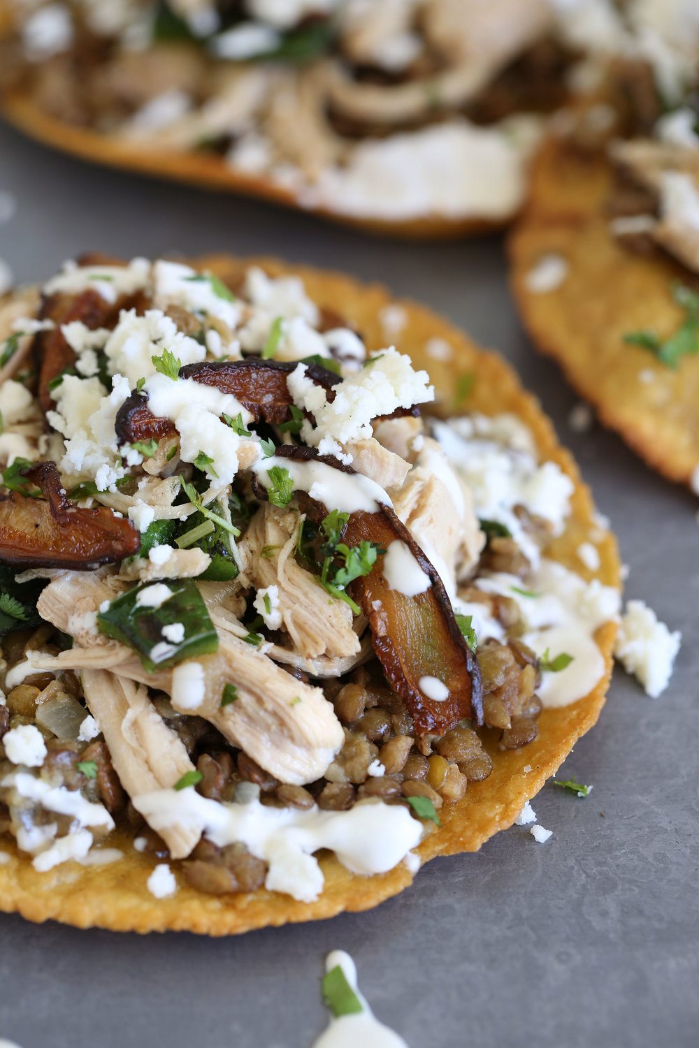 braised chicken tostada with refried lentils