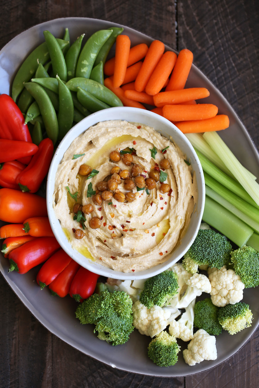 spicy hummus with roasted chickpeas and veggies