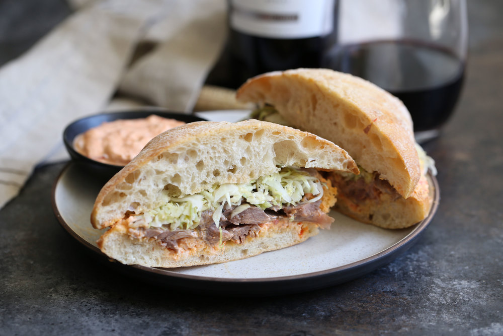 greek lamb sandwich with harissa yogurt sauce