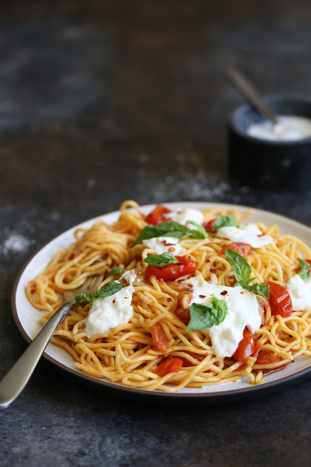 spaghetti with confit tomatoes, buratta and basil
