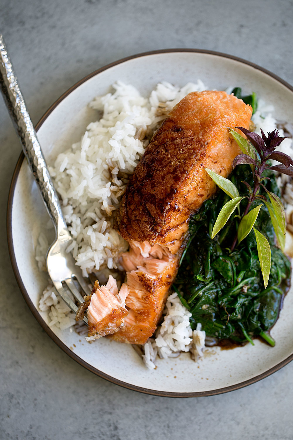 crispy salmon with soy tamarind sauce over spinach