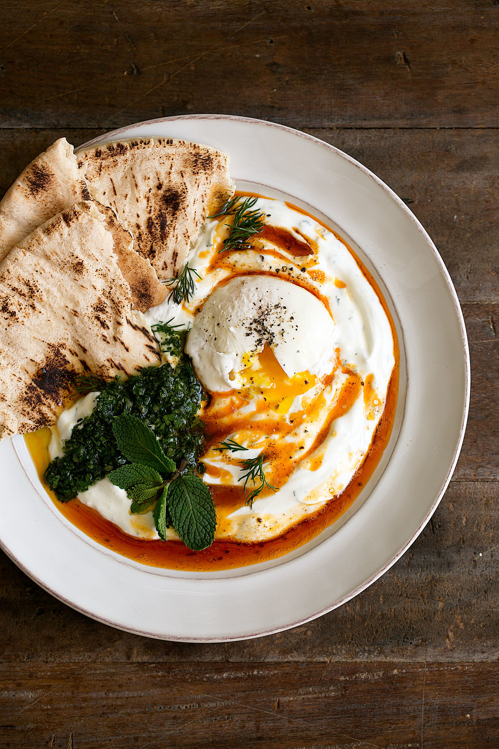 turkish poached eggs and yogurt and herbs