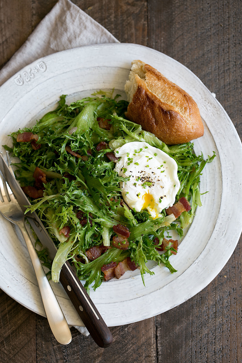 bacon and frisée salad with a poached egg
